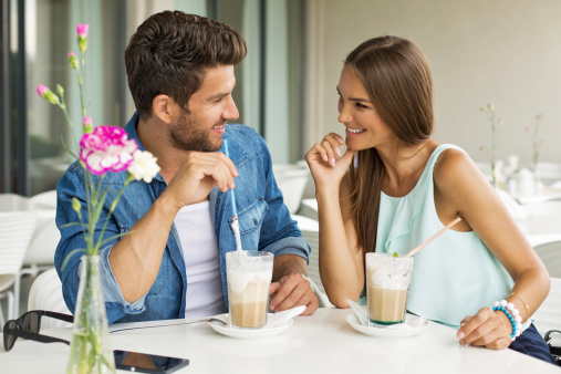 Smiling couple in cafe